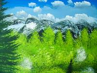 Snowy peaks and new green leaves