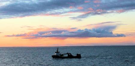 Fishing boat at sunset on Bristol Bay