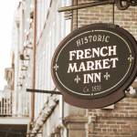 """New Orleans Hotel Sign in Sepia"" by Groecar"