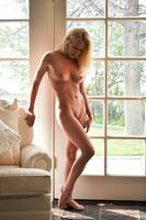 Blond nude by the window