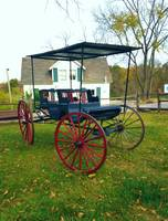 Vintage Buggy In Front of Small Farmhouse