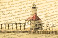 Lighthouse along shoreline of Lake Michigan