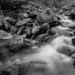 """Boulder Creek Water Falling in Monochrome"" by lightningman"