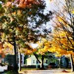 """Autumn Street with Yellow House"" by susansartgallery"