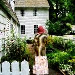 """Woman With Striped Jacket and Flowered Skirt"" by susansartgallery"