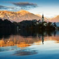 Sunset over Lake Bled Art Prints & Posters by Ian Middleton