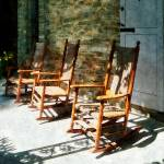 """Three Wooden Rocking Chairs on Sunny Porch"" by susansartgallery"