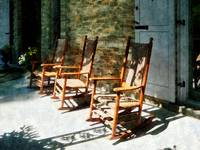 Three Wooden Rocking Chairs on Sunny Porch