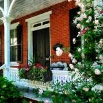 """Porch With Climbing Roses"" by susansartgallery"