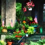 """Porch With Geraniums and American Flags"" by susansartgallery"