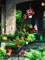 Porch With Geraniums and American Flags