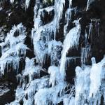"""Icicles seep down a cliff in North Cascades Natl P"" by JohnChaoPhoto"