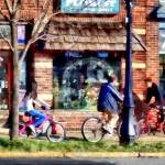 """Metuchen NJ - Bicyclists on Main Street"" by susansartgallery"
