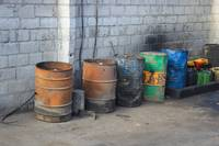 Colorful Barrels Next to a Wall
