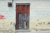 Red Wood Door in a Wall