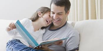 Daddy Reads To His Daughter