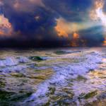 """stormy cloudy ocean sunset blue waves rays"" by eszra"