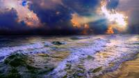 stormy cloudy ocean sunset blue waves rays