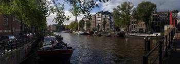 Panoramic view on Houseboats and Canal Houses in A