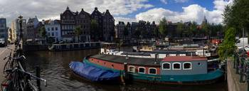 Houseboats And Canal Houses In Amsterdam