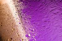 Water drops on golden and purple