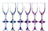 Colorful glasses in front of white background