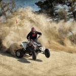 """ATV on Dirt Road in Dust Cloud"" by ElainePlesser"