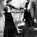 """Mug.bonnie holding gun on clydeimp"" by RubinoFineArt"