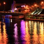 """Colorful lights shine on the Intercoastal Waterway"" by RoupenBaker"