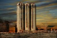 Silos and Farm at Sunset