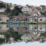"""Buildings Reflected in Lake Yaraucocha"" by rhamm"