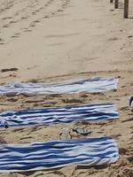 Three Towels on Beach