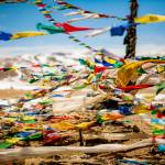 """Buddhist Prayer flags in Tibet"" by ExposedPlanet"