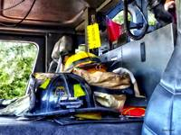 Two Firefighter's Helmets Inside Fire Truck