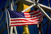 American Flag Against Oil Drilling Rig Derrick