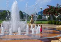 Girl playing in Fountain