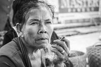 Burmese woman smoking a cheroot
