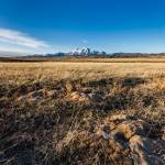 """Grassland with mountain background"" by Landscapes"