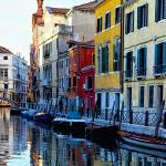 """Colorful Houses Along a Canal Santa Croce, Venice"" by George_Oze"