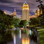 """Tower Life Building Reflection at Riverwalk"" by eyeates"