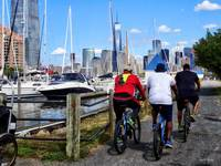Three Bicyclists By Liberty Landing Marina
