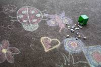 Kids drawing on asphalt