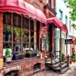 """Alexandria VA - Red Awnings on King Street"" by susansartgallery"