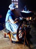 Colonial Woman Spinning