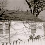 """white fence and shadowed house painting photo"" by jnanian"
