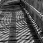 """Boardwalk Shadows - Black and White"" by KsWorldArt"