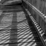 """Boardwalk Shadows - Black and White"" by KsWorldArt"