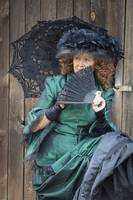 Re-enactor with Old Fashioned Green Dress