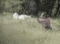 Re-enactor Firing Old Gun