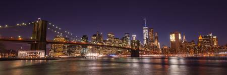 New York City Skyline with Brooklyn Bridge at Nigh